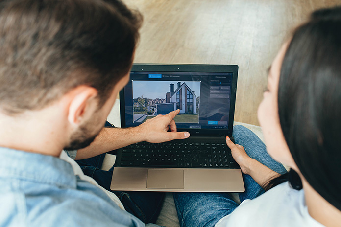 A couple searching for a property online